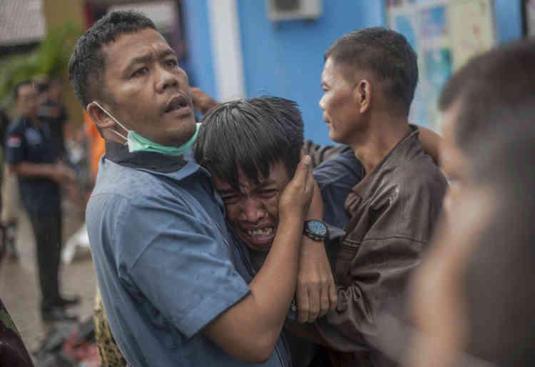 Un survivant vient d'identifierun procheparmiles victimes, àCarita, le 23 décembre.