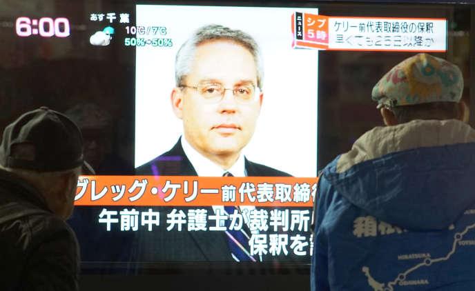 Greg Kelly apparaissant au journal télévisé, le 21 décembre, à Tokyo.