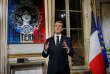 French President Emmanuel Macron gestures as he poses for a photograph after the recording of his New Year's speech at at the Elysee Palace, in Paris, France December 31, 2018. Michel Euler/Pool via REUTERS