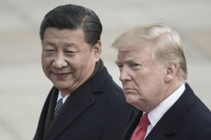 Le président chinois, Xi Jinping, et son homologue américain, Donald Trump, à Pékin, en novembre 2017.