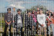 Tourists from Tokyo's universities, are reflected in a cenotaph to mourn for the victims of the March 11, 2011 earthquake and tsunami, at an area devastated by the disaster, near Tokyo Electric Power Co's (TEPCO) tsunami-crippled Fukushima Daiichi nuclear power plant, in Namie town, Fukushima prefecture, Japan May 19, 2018. Picture taken May 19, 2018.   REUTERS/Toru Hanai - RC12E7885B30