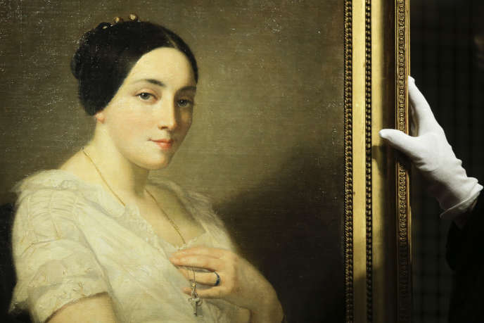 La toile « Portrait de femme », de Thomas Couture (1815-1879) durant la cérémonie de restitution mardi 8 janvier, à Berlin.The painting 'Portrait of a Seated Young Woman' by Thomas Couture stands on a easel during a restitution ceremony to the heirs of Jewish French politician Georges Mandel in Berlin, Tuesday, Jan. 8, 2019. The painting was discovered in the art trove of late collector Cornelius Gurlitt and belonged to Georges Mandel, a Jewish French politician and resistance figure who was executed during World War II. (AP Photo/Markus Schreiber)