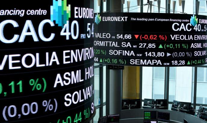 Lescotationsdes sociétés du CAC 40 affichées au siège d'Euronext à laDéfense, près de Paris, le 27avril 2018.