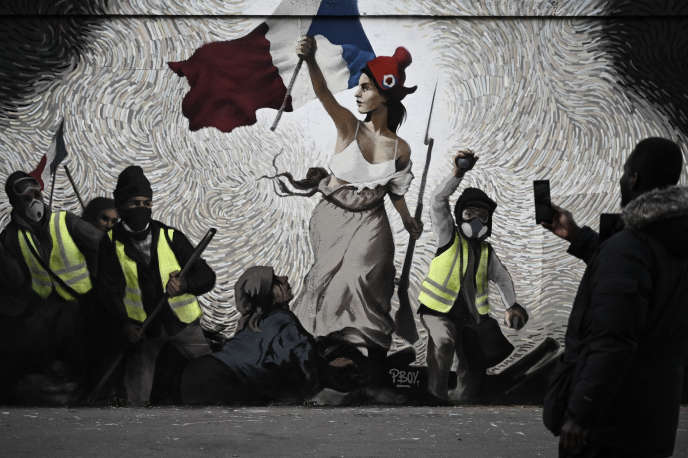 « La Liberté guidant le peuple 2019 », fresque réalisée par le street-artiste Pboy, rue d'Aubervilliers, à Paris 19e.