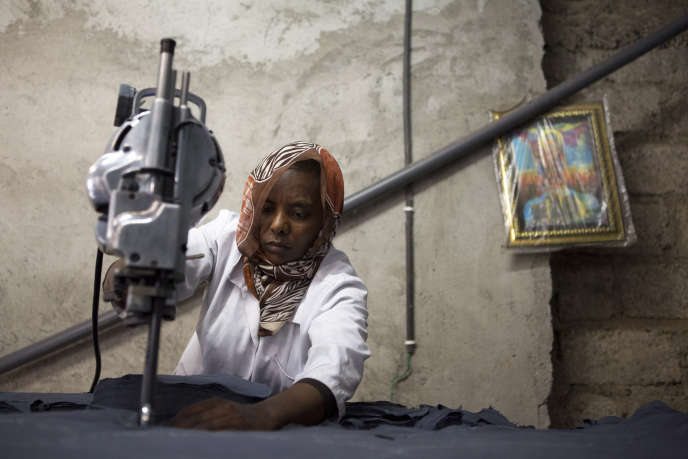 Maryod plant worker cuts cloth to make reusable sanitary napkins in Addis Ababa, Ethiopia, in September 2017.