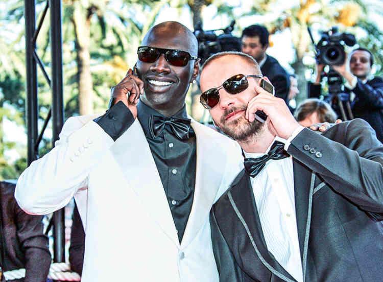 2007, Marrant. Omar Sy est à Cannes, mais, ne vous y trompez pas, il a déjà monté toutes les marches. Fils d'une femme de ménage mauritanienne et d'un ouvrier sénégalais, le jeune homme a grandi à Trappes, dans les Yvelines, a rencontré Jamel, et est entré à Nova. Puis il croise la route de Fred Testot, commence à faire de la télé, notamment sur Canal+, et le voilà désormais sur la Croisette, où son sens de l'humour brille plus que son sens du style. Vêtu du même smoking blanc cassé, Sean Connery était en effet moins drôle dans «Goldfinger». Mais beaucoup plus chic.