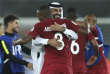 L'équipe qatarie fête sa victoire contre celle d'Arabie saoudite, auZayedSportCityStadium d'Abou Dhabi, le 17 janvier.