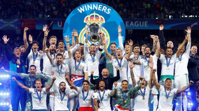 Les joueurs du Real Madrid célèbrent leur victoire en Ligue des champions, à Kiev, en Ukraine, le 26 mai 2018.