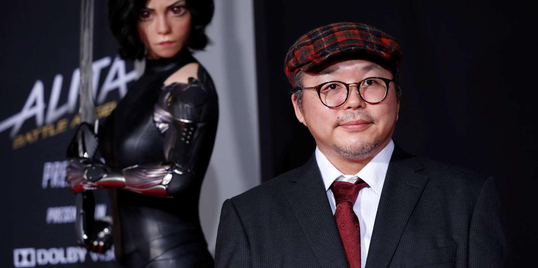 Novel creator Yukito Kishiro poses at the premiere for the movie