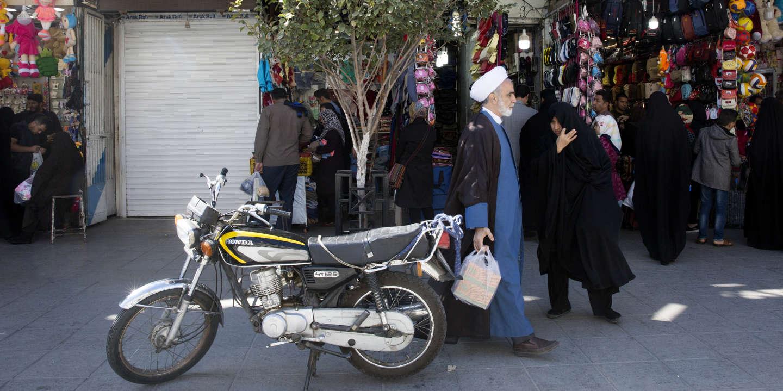 An Iranian clergyman makes his way at the city of Qom 78 miles (125 kilometers) south of the capital Tehran, Iran, Nov. 1, 2018.