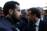 FILE PHOTO: Senior Elysee senior security officer Alexandre Benalla (L) stands next to French President Emmanuel Macron during a visit to the Paris International Agricultural Show, February 24, 2018. REUTERS/Stephane Mahe/Pool/File Photo