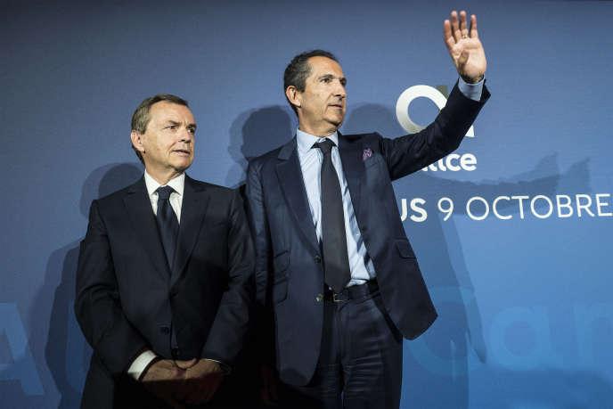 Alain Weill, président d'Altice France (qui devient l'actionnaire majoritaire à titre personnel de « L'Express »), et Patrick Drahi, président du groupe Altice, à Paris, en octobre 2018.