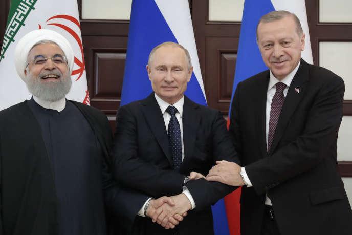 Le président iranien, Hassan Rohani, le président russe, Vladimir Poutine, et le président turc, Recep Tayyip Erdogan, à Sotchi (Russie), le 14 février.