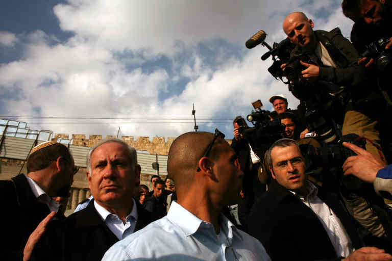 JERUSALEM - FEBRUARY 02: (ISRAEL OUT) Israeli opposition leader Benjamin Netanyahu (L) is surrounded by media during a campaign tour February 2, 2009 in east Jerusalem, Israel. The truce between Israel and Hamas has become increasingly tenuous, posing a challenge to the centrist-led Israeli government as the February 10 elections near. (Photo by Uriel Sinai/Getty Images)