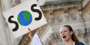 "Young demonstrators hold placards as they attend a climate change protest organised by ""Youth Strike 4 Climate"", on Whitehall in central London on February 15, 2019. Hundreds of young people took to the streets to demonstrate Friday, with some of them having gone on strike from school, as part of a global youth action over climate change. / AFP / Ben STANSALL"
