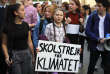 """Swedish teenager Greta Thunberg, center, leads a march of thousands of French students through Paris, France, to draw more attention to fighting climate change, Friday, Feb. 22, 2019. Sign reads : """"school strike for the climate"""". (AP Photo/Francois Mori)"""