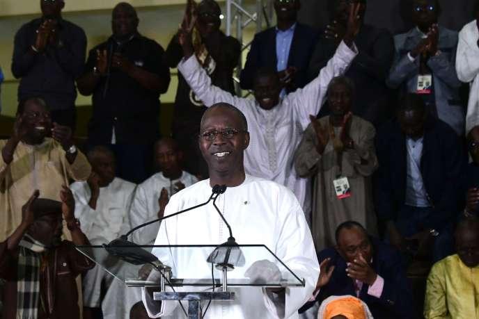 Lepremier ministresénégalais MahammedBuonAbdallahDionneannonçant la victoire du président sortantMackySall, à Dakar, le 24 février.