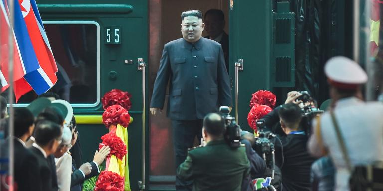 TOPSHOT - North Korean leader Kim Jong Un (C) arrives at the Dong Dang railway station in Dong Dang, Lang Son province, on February 26, 2019, to attend the second US-North Korea summit. North Korean leader Kim Jong Un crossed into Vietnam on February 26 after a marathon train journey for a second summit showdown with Donald Trump, with the world looking for concrete progress over the North's nuclear programme. / AFP / Nhac NGUYEN