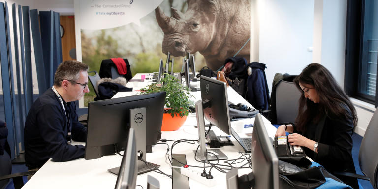 Employees work on computers at the French start-up Sigfox offices in Paris, France, February 14, 2018. REUTERS/Benoit Tessier - RC153FE109E0