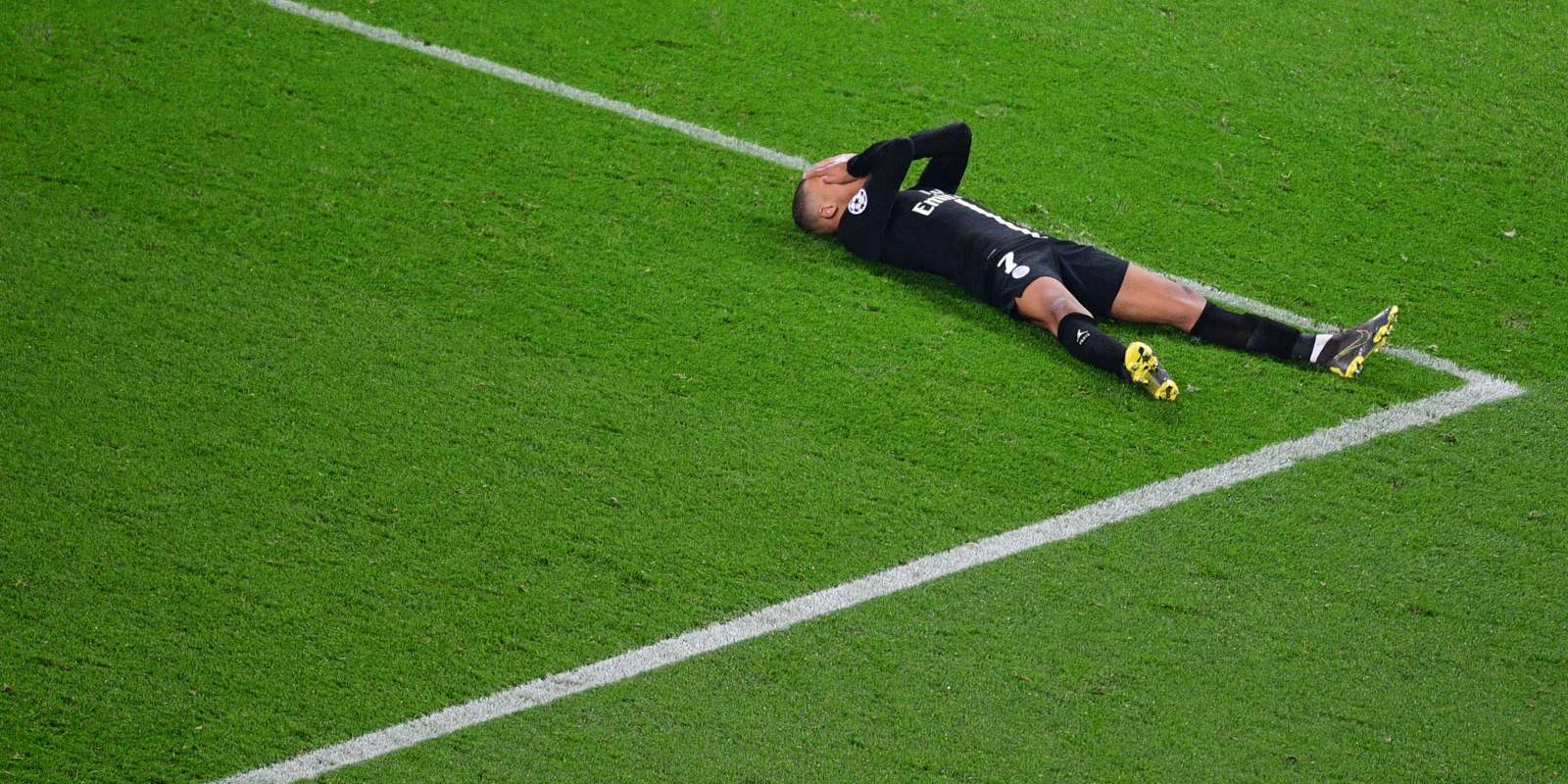 Paris Saint-Germain's French forward Kylian Mbappe reacts as he lies on the pitch at the end of the UEFA Champions League round of 16 second-leg football match between Paris Saint-Germain (PSG) and Manchester United at the Parc des Princes stadium in Paris on March 6, 2019. / AFP / Martin BUREAU
