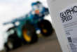FILE PHOTO: A can of glyphosate weedkiller is seen in front of a tractor in Ouzouer-sous-Bellegarde, France, November 30, 2017. REUTERS/Christian Hartmann/File Photo