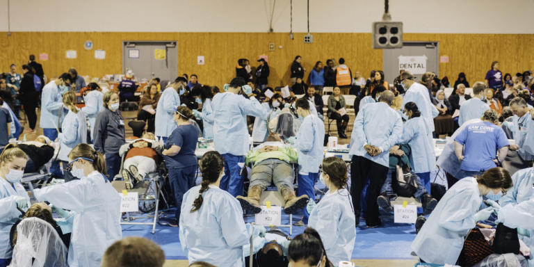 March 2nd, 2019, Harrisonburg, Virginia, USA: Remote Area Medical, commonly known as RAM, provides healthcare services to people who can't afford treatment otherwise. In order to receive treatment people showed up at midnight the previous night to get a ticket. After staying in their cars for several hours, soon to be patients lined up at 5 a.m. and waited, sometimes for hours, for their numbers to be called out.   Seen here is he main operating theatre of the clinic, the overwhelming majority of patients came to have dental work done.     ///Lee Hoagland Pour Le Monde///