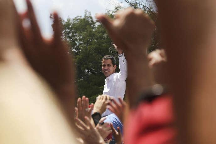 Près de 10 000 manifestants ont convergé vers le lieu du rassemblement avec l'opposant venezuelien Juan Guaido, le 9 mars à Caracas.
