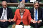 La première ministre Theresa May au Parlement britannique, mardi 12 mars, lors du deuxième vote des députés sur l'accord négocié avec l'Union européenne sur le Brexit.