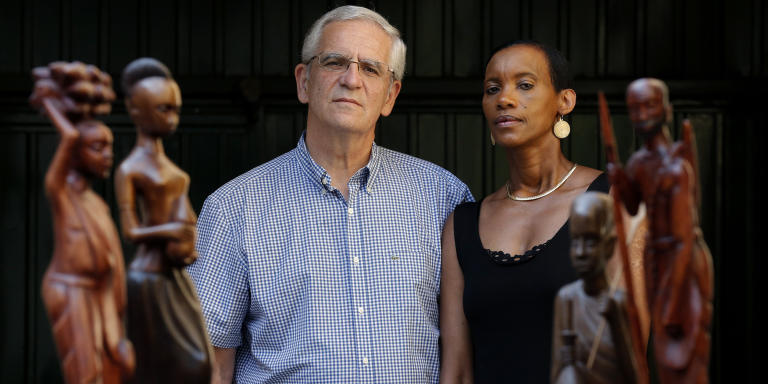 Rwanda's genocide-hunting couple Alain (L) and Dafroza Gauthier pose behind traditional wooden statues at their home in Reims, September 6, 2013. People often compare them to Serge and Beate Klarsfeld, a much celebrated activist couple who dedicated their lives to hunting down Nazis from France. The comparison makes them smile. She a Rwandan trained in chemical engineering, he a French high school teacher, their same determination to see justice done has seen Alain and Dafroza Gauthier devote a decade to tracking down some three dozens presumed accomplices of the 1994 Rwandan genocide who had been living quietly in France. In February, the first of them - a 53-year-old former soldier who allegedly supplied killers with arms and instructions and who some in Rwanda nickname