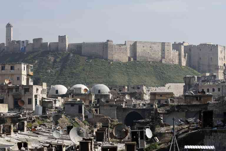 A general view shows the Saqatiya market, during restoration, and the Citadel of Aleppo, in the old quarter of Syria's second city of Aleppo on February 12, 2019. Restoration works began on November 1 after Syrian authorities signed a partnership agreement with the Aga Khan Foundation in Syria. Workers are focusing on erasing all
