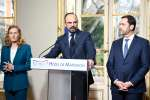 French Prime Minister Edouard Philippe (C) gives a press conference next to French Interior Minister Christophe Castaner (R) and French Justice Minister Nicole Belloubet (L), on March 18, 2019 at the Matignon hotel in Paris, to announce measures after weekend riots. / AFP / Bertrand GUAY