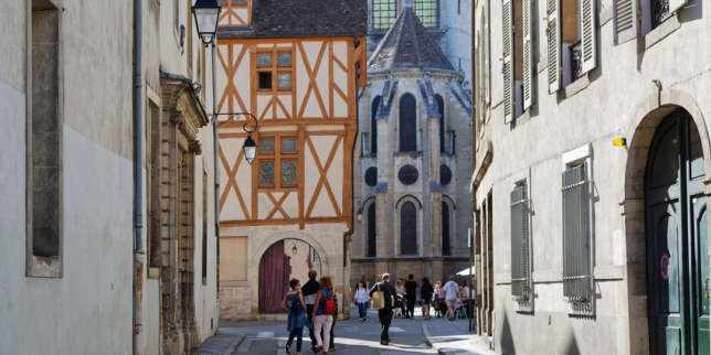 DIJON, FRANCE, May 20, 2018 : Small street and ancient architecture in the heart of the preserved old center of the city.