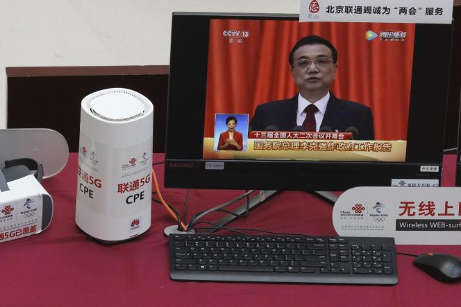 Démonstrationde technologie5Gpar le groupe chinoisHuaweidurant lediscoursdupremier ministreLi Keqiang àPékin, le 6 mars.
