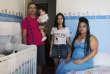 AdailtonSantosOliveira, son épouse, son petit-fils de 8 mois, et sa fille dans leur appartement «occupé» du quartier Bela Vista de Sao Paulo.