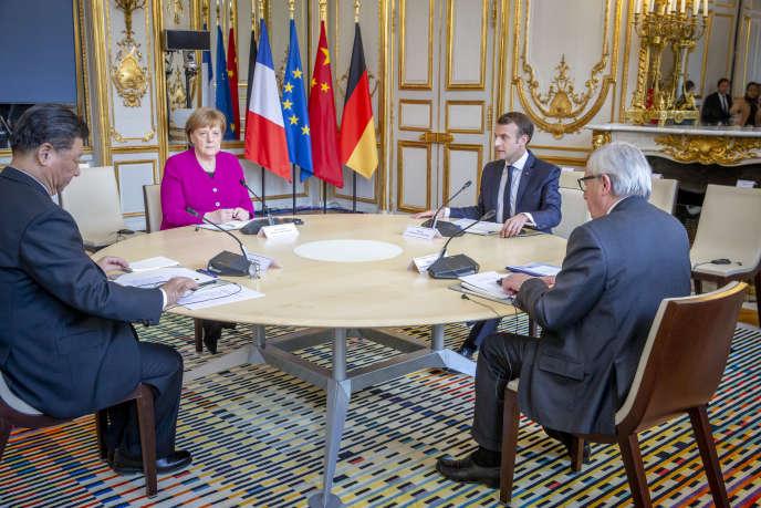Rencontre entre Emmanuel Macron, président de la République française, Angela Merkel, chancelière allemande, Jean-Claude Junker, président de la Commission européenne et le président chinois Xi Jinping, à l'Elysée, mardi 26 mars 2019.