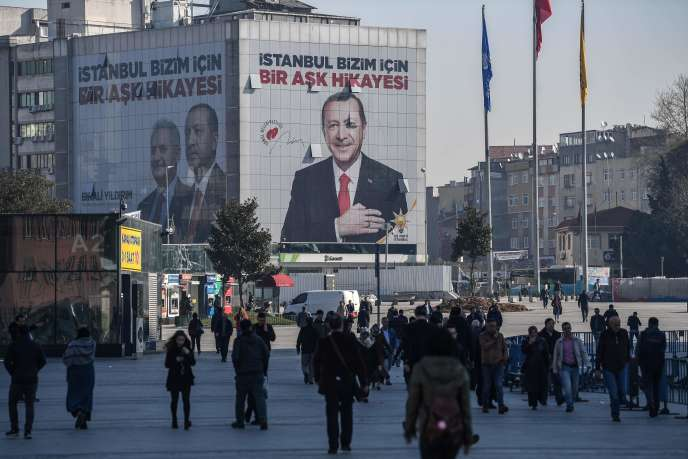 A giant election poster for Turkish local elections bearing a picture of Turkish President Recep Tayyip Erdogan and reading
