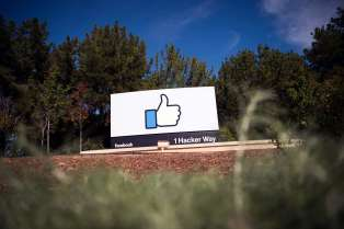 "(FILES) In this file photo taken on November 4, 2016, the Facebook sign and logo are seen in Menlo Park, California.  Facebook on March 29, 2019, said it is tightening live video streaming rules in response to the service being used to broadcast deadly attacks on mosques in New Zealand. The Christchurch attacks -- carried out by a self-avowed white supremacist who opened fire on worshippers at two mosques -- claimed 50 lives. Many people have ""rightly questioned how online platforms such as Facebook were used to circulate horrific videos of the attack,"" chief operating officer Sheryl Sandberg said in an online post.  / AFP / JOSH EDELSON"