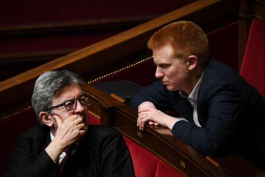 Jean-Luc Mélenchon, chef de file de La France insoumise, et le député Adrien Quatennens, le 2 avril, à l'Assemblée nationale.