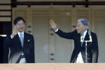 "FILE - In this Jan. 2, 2018, file photo, Japan's Emperor Akihito, right, with Crown Prince Naruhito waves to well-wishers from the bullet-proofed balcony during his New Year's public appearance with his family members at Imperial Palace in Tokyo. Japan's government says the translation of the new era name is ""beautiful harmony,"" setting off confusion while offices rush to make changes before Crown Prince Naruhito takes the throne. The era of ""Reiwa"" begins May 1, 2019, a day after 85-year-old Emperor Akihito abdicates in favor of his elder son. (AP Photo/Eugene Hoshiko, File)"