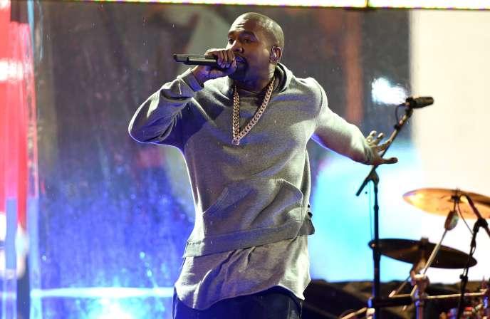 Kanye West, durant un concert sur Times Square, à New York, en décembre 2014. L'application Dice se targue d'avoir déjà pris en charge dans les pays anglo-saxons la billetterie d'artistes comme A$AP Rocky, Angèle ou bien encore Kanye West.