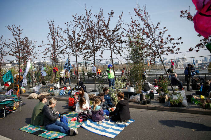 Environmental activists block the Waterloo Bridge during a protest against the Extinction rebellion in London on April 15.