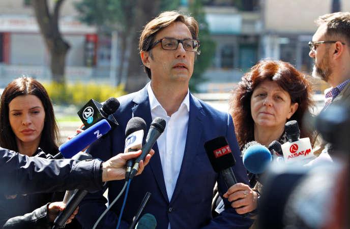 Candidate Stevo Pendarovski addresses journalists after voting in Skopje on April 21.
