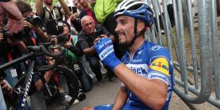 French Julian Alaphilippe of Deceuninck - Quick-Step sits on the ground after winning the 83rd edition of the men's race of 'La Fleche Wallonne', a one day cycling race (Waalse Pijl - Walloon Arrow), 195,5km from Ans to Huy, on April 24, 2019. Belgium OUT / AFP / BELGA / Belga / BENOIT DOPPAGNE