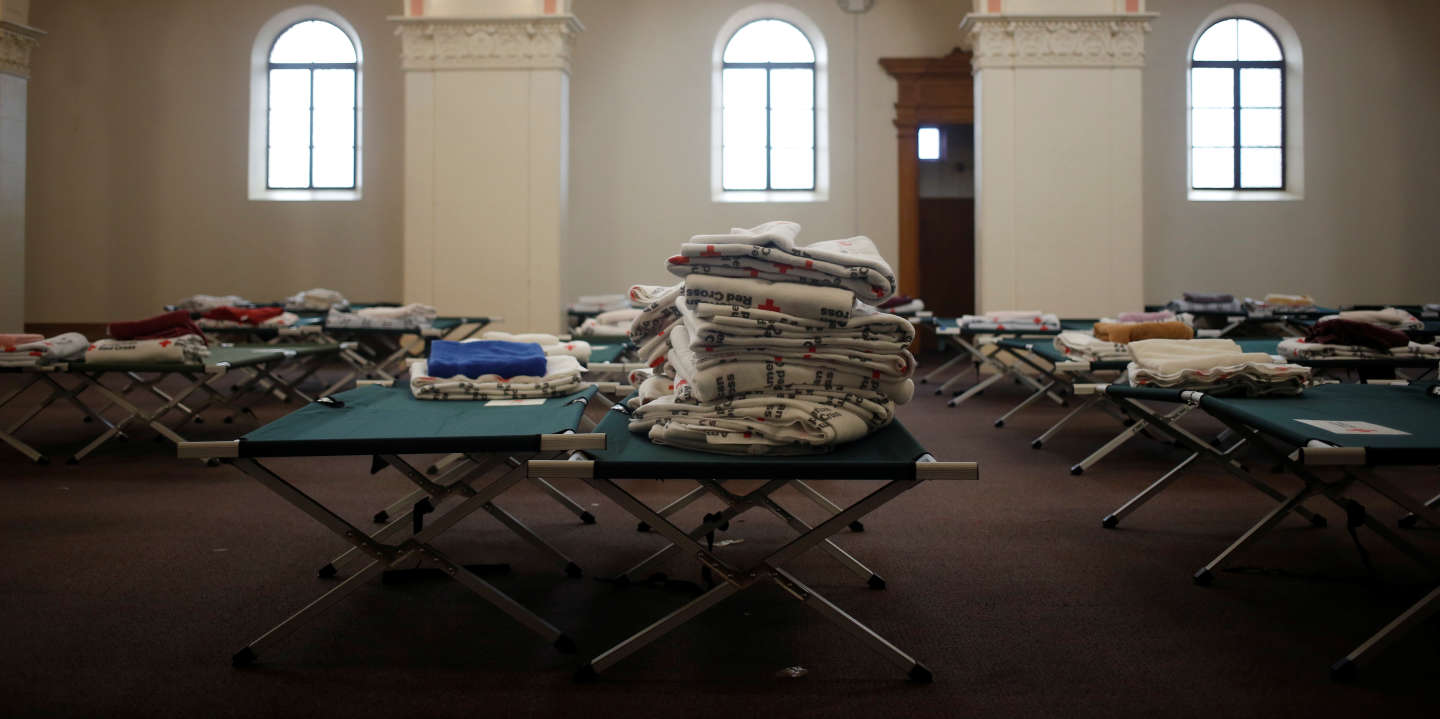 Red Cross blankets and cots fill the chapel of a monastery in preparation for large groups of migrants in Tucson, Arizona, U.S. February 21, 2019. REUTERS/Nicole Neri  SEARCH