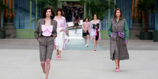 Models present creations during the Cruise 2020 collection show for French fashion house Chanel at the Grand Palais in Paris, France, May 3, 2019.