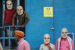 India's ruling Bharatiya Janata Party (BJP) supporters wear masks of Indian prime minister Narendra Modi and wait for his arrival during an election campaign rally in Prayagraj, India, Thursday, May 9, 2019. India's multi-phase elections, which started April 11 and last five weeks, are seen as a referendum on Prime Minister Narendra Modi and his Hindu nationalist BJP. (AP Photo/Rajesh Kumar Singh)