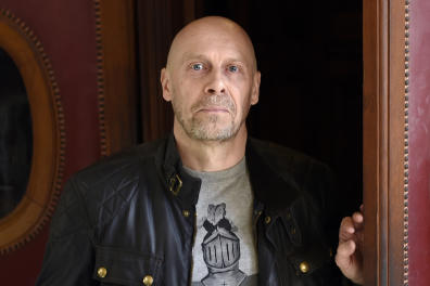 (FILES) In this file photo taken on March 12, 2015 French far-right writer Alain Soral poses holding disc as he arrives at the Paris courthouse in Paris on March 12, 2015. - The Paris courthouse will deliberate on April 15, 2019 for the trial of Alain Soral and his lawyer Damien Viguier, tried for Holocaust denial. The prosecution is seeking a six months sentence for the right-wing essayist and a 15,000 Euro fine for his lawyer. (Photo by LOIC VENANCE / AFP)