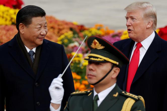Le président des Etats-Unis, Donald Trump (à droite), et son homologue chinois,Xi Jinping, à la Grande Halle de Pékin, en novembre 2017.