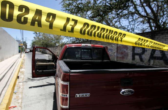 C'est dans un ranch d'un quartier dela ville de Zapopan, gardé ici par la police, dans l'Etat mexicain de Jalisco qu'ont été découverts 27 corps cette semaine.