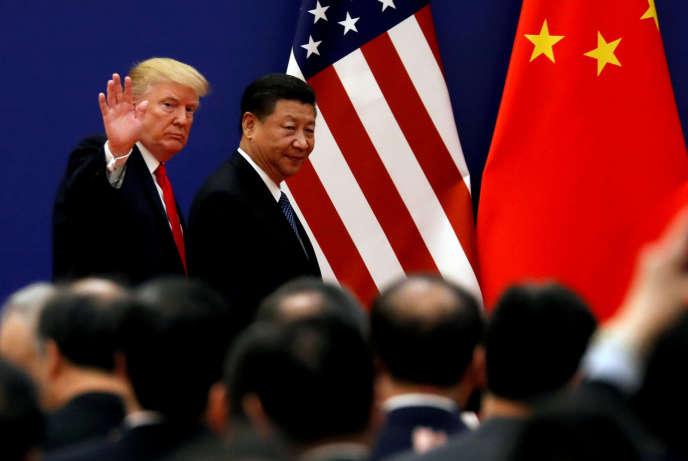 Le président américain Donald Trump et son homologue chinois Xi Jinping lors d'une rencontre avec des chefs d'entreprise à Pékin (Chine), le 9 novembre 2017.
